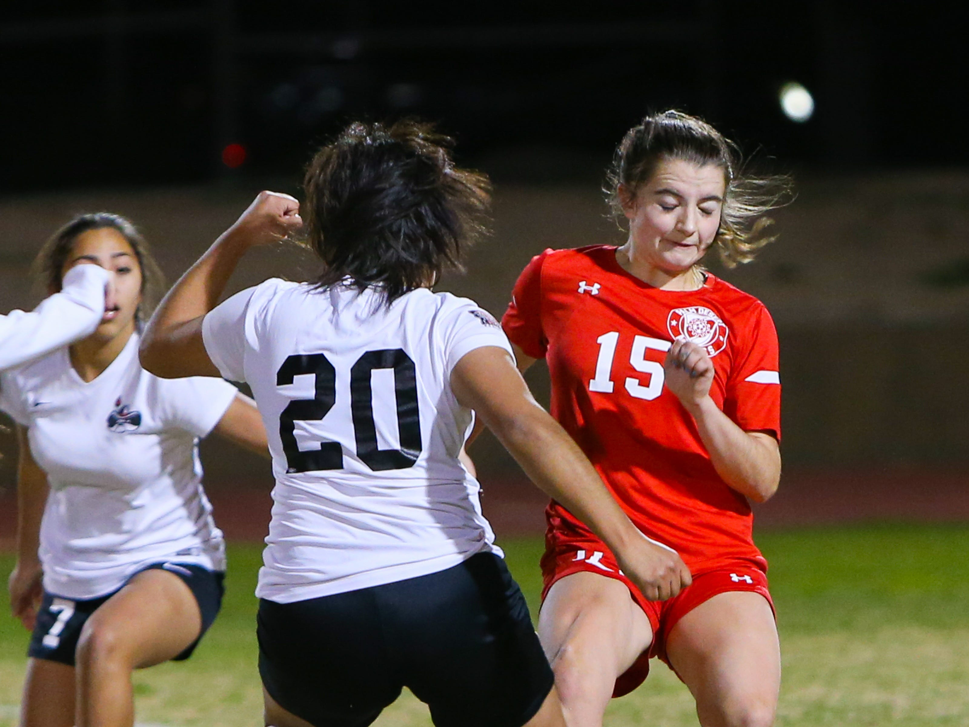 Players collided with each other while racing towards the ball. The Palm Desert varsity soccer team won Wednesday's home playoff game against Miller by a score of 5-1.