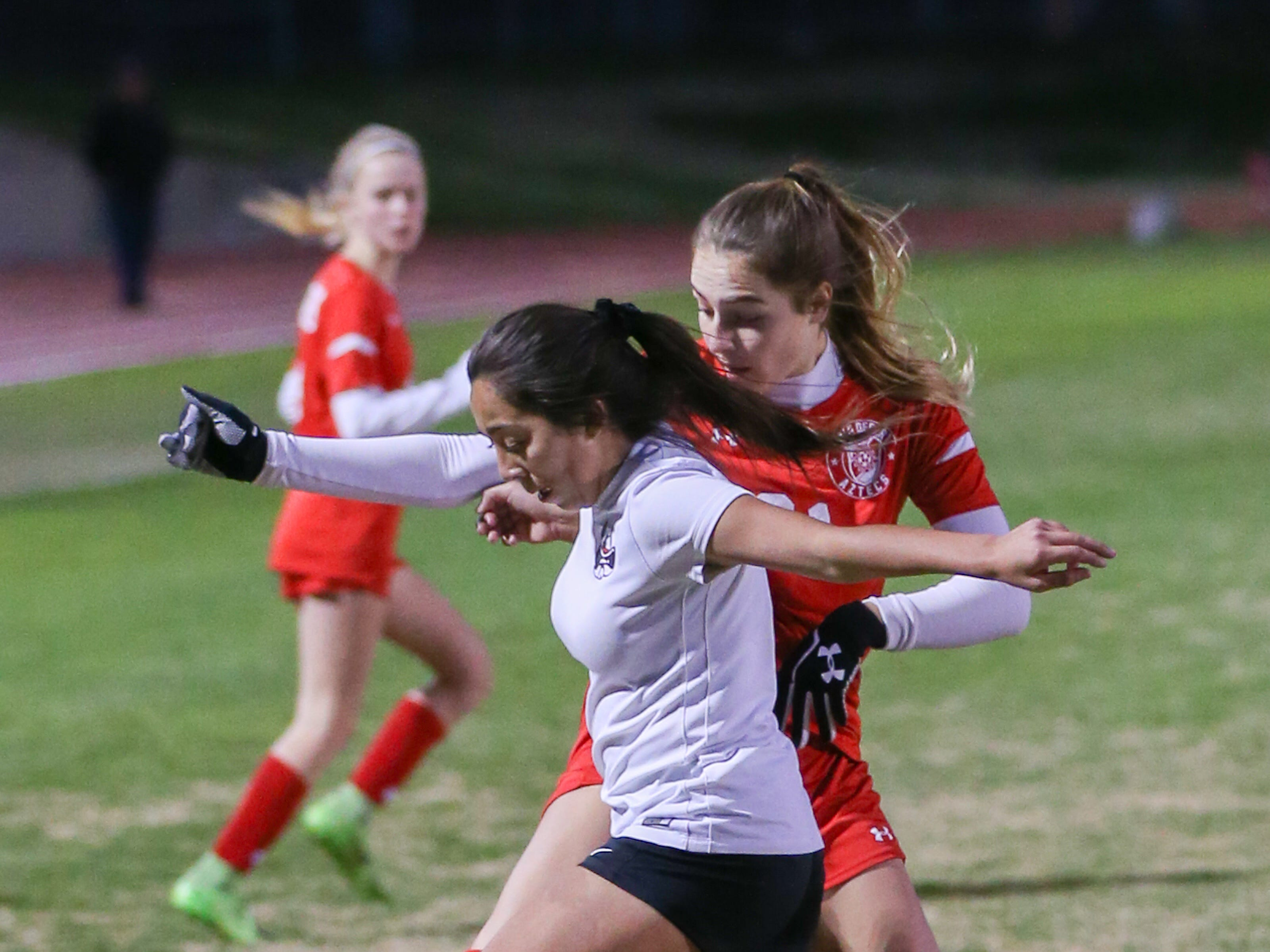Ivana Gottwald sweeps the ball from the opponent. The Palm Desert varsity soccer team won Wednesday's home playoff game against Miller by a score of 5-1.