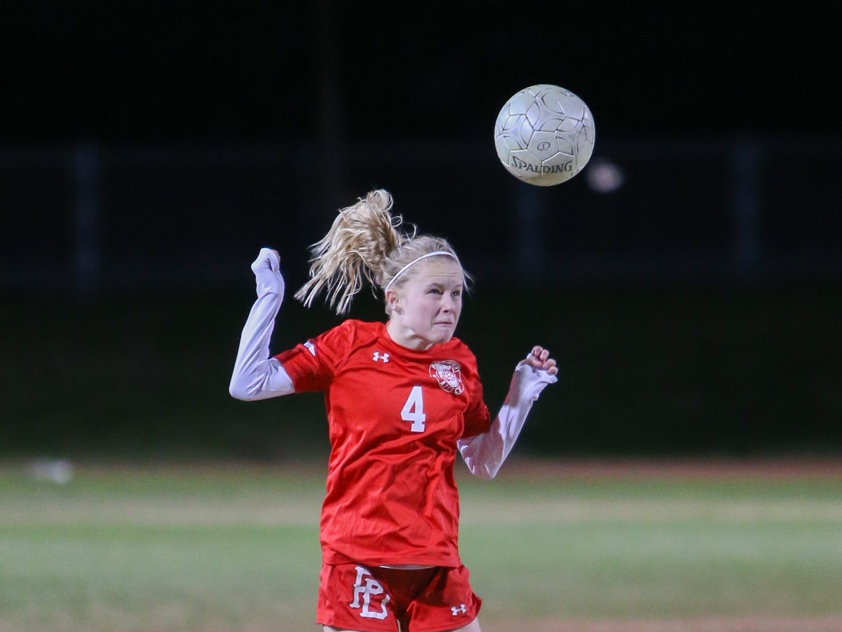 Julia Dore heads the ball. The Palm Desert varsity soccer team won Wednesday's home playoff game against Miller by a score of 5-1.