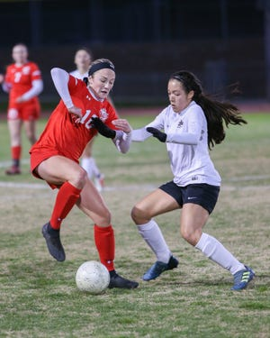 Kaci Holliday stops the ball from going the opposite direction. The Palm Desert varsity soccer team won Wednesday's home playoff game against Miller by a score of 5-1.