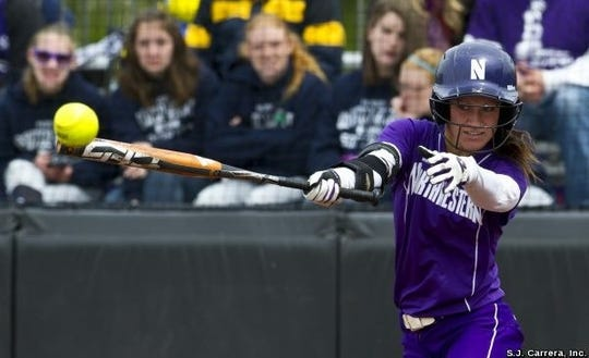 Kristin Scharkey launches a shot during her playing days at Northwestern University.
