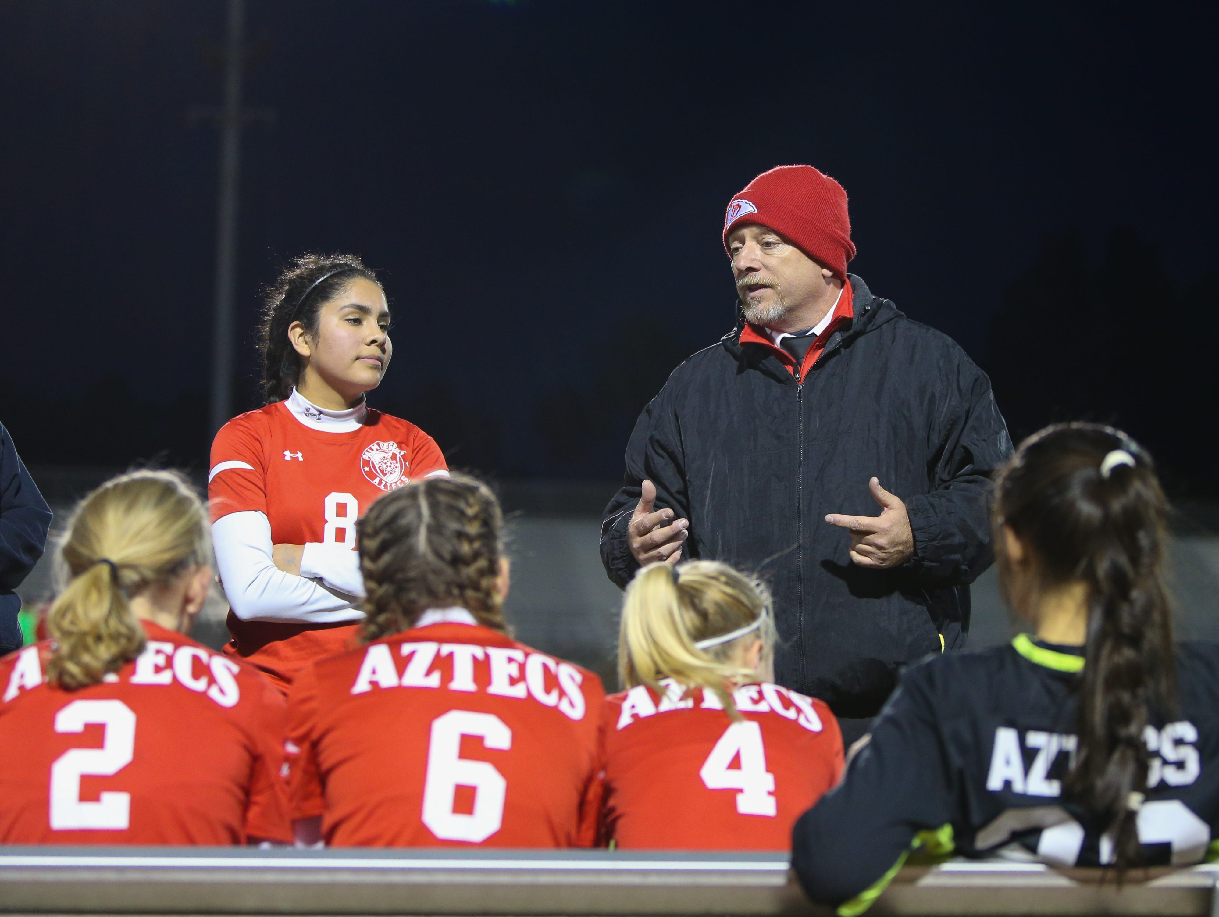 Chris Keuilian talks to his players in between break. The Palm Desert varsity soccer team won Wednesday's home playoff game against Miller by a score of 5-1.