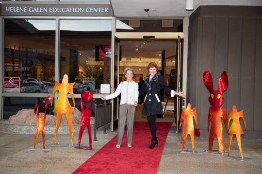 On the Red Carpet, Linda Rider and Jennie Inch are flanked by sculptures created by Karen and Tony Barone.