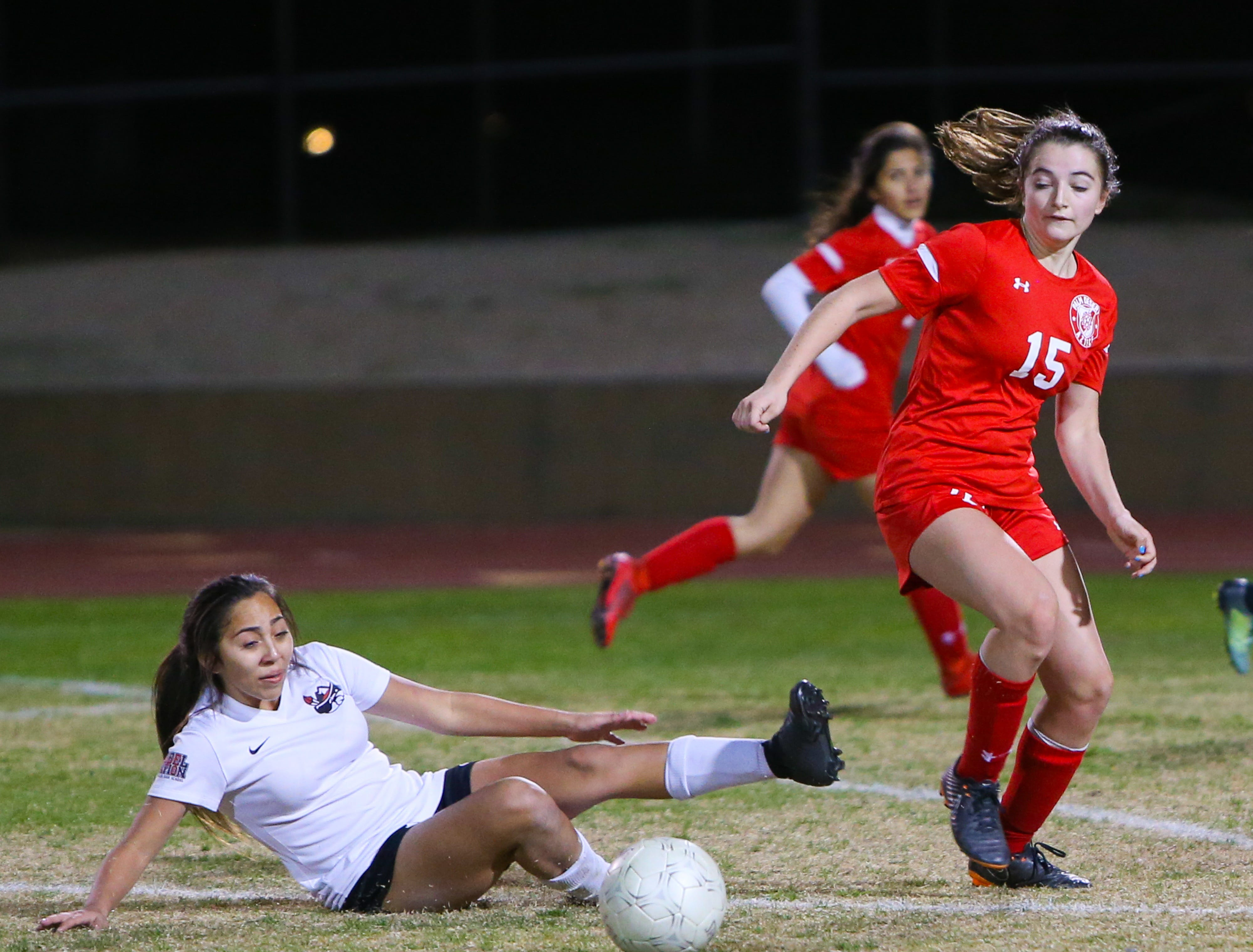 Malia Falk takes the ball from an AB Miller player. The Palm Desert varsity soccer team won Wednesday's home playoff game against Miller by a score of 5-1.