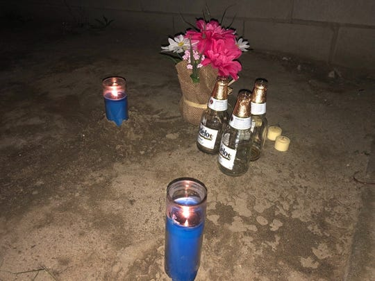 A makeshift memorial in remembrance of the 3 teens killed earlier this week in Palm Springs sits, Wednesday night, near the scene where their bodies were found inside a crashed Toyota Corolla.