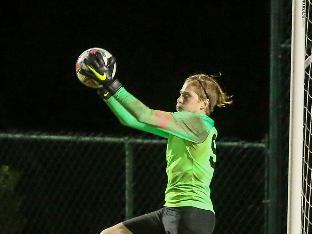 Mosley goalkeeper Zach Moenter (99) stops a West Florida shot in the Region 1-3A quarterfinal game at Ashton Brosnaham Park on Wednesday, February 6, 2019. Mosley beat West Florida 2-1 and advances to the next round.