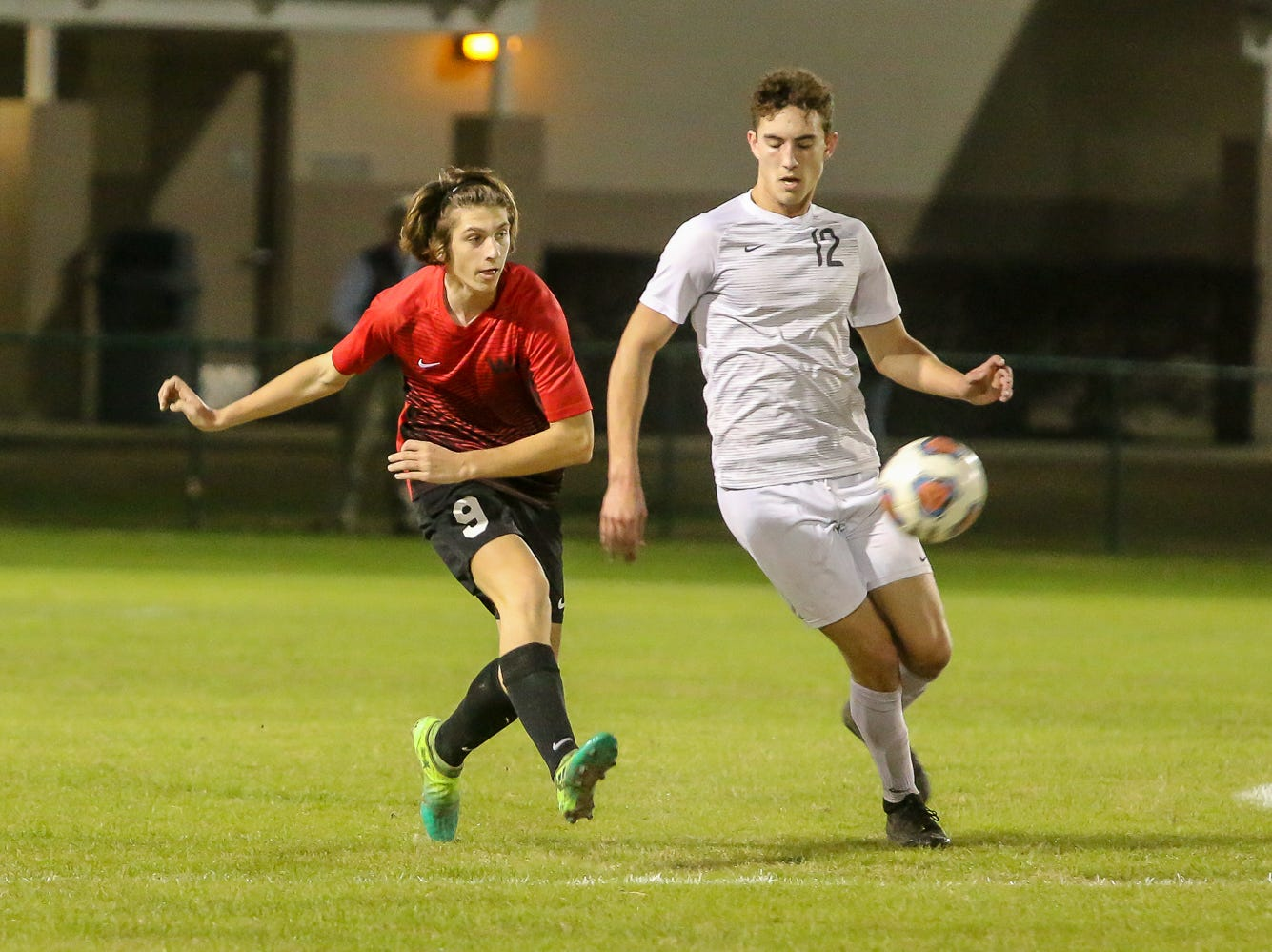 West Florida's Quinn Baker (9) passes the ball away from Mosley's Nick French (12) in the Region 1-3A quarterfinal game at Ashton Brosnaham Park on Wednesday, February 6, 2019. Mosley beat West Florida 2-1 and advances to the next round.