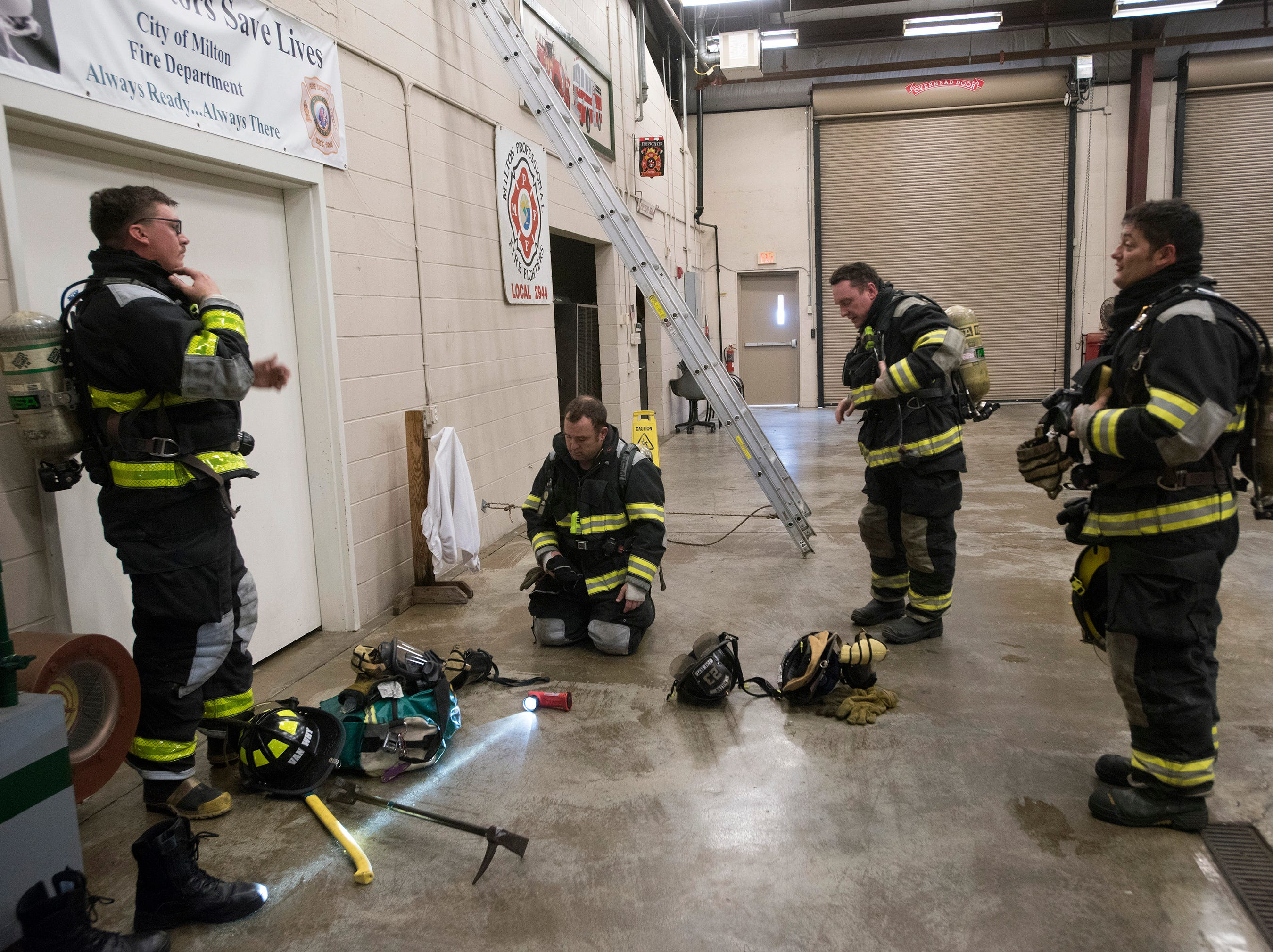 Milton Firefighters prepare for training at the Stewart Street fire station on Thursday, Feb. 7, 2019. The Milton FD released its annual report this week and said their calls for service increased exponentially last year.