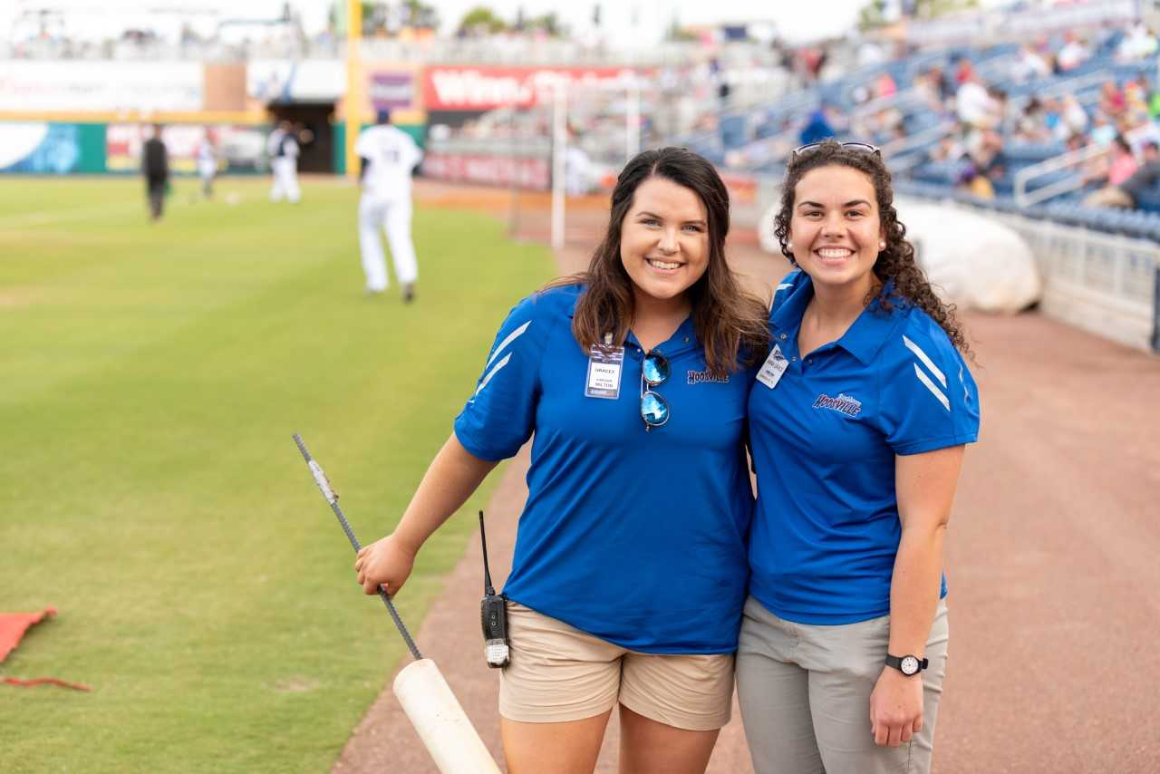 Blue Wahoos' season ticket concierge Gracey McDonald, left, with Anna Grace Carrick, right, members of last year's internship program.
