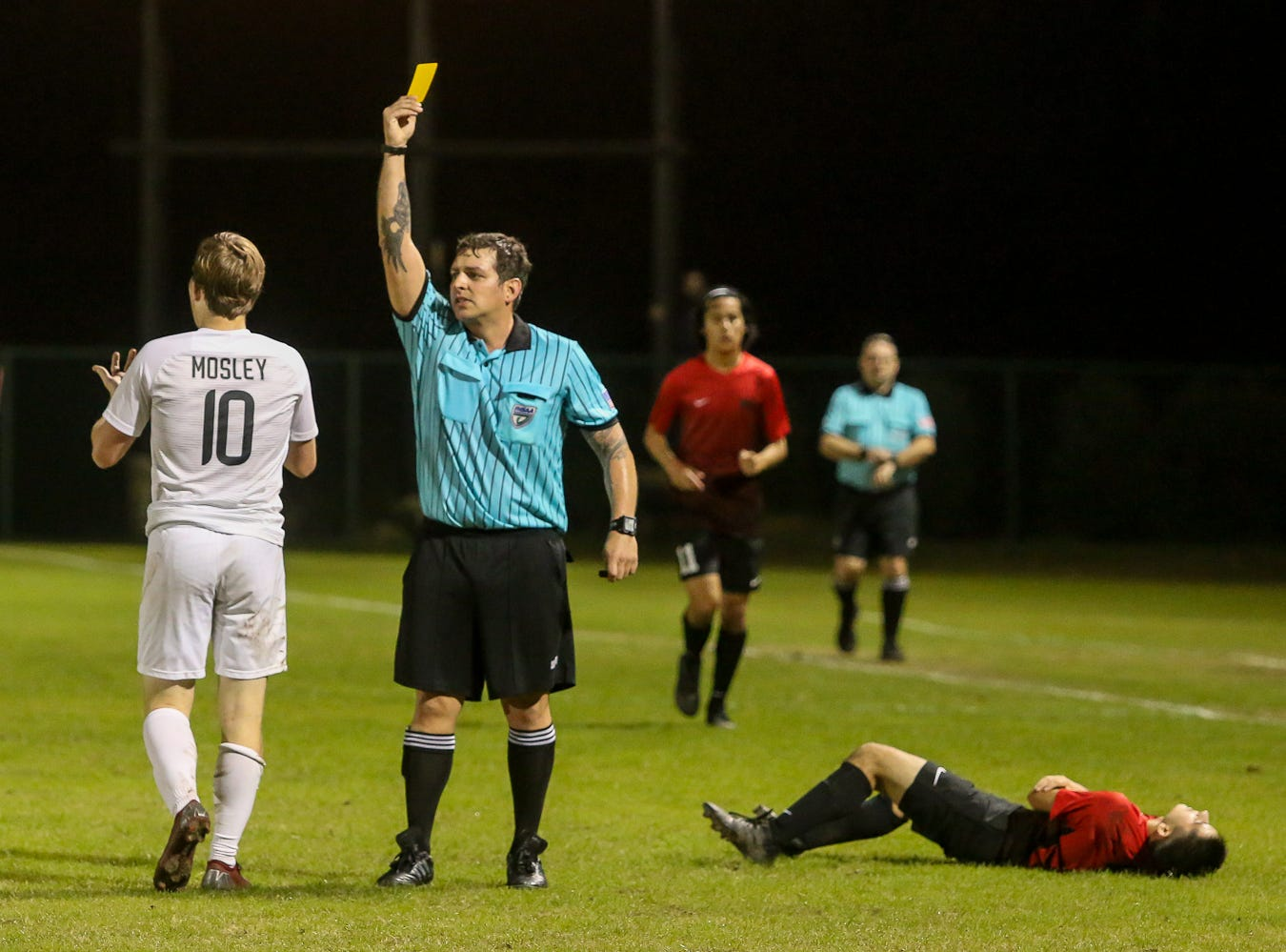 Mosley's Austin Priemer (10) is given a yellow card after tripping up West Florida's Justin Wamsley (17) near the sideline in the Region 1-3A quarterfinal game at Ashton Brosnaham Park on Wednesday, February 6, 2019. Mosley beat West Florida 2-1 and advances to the next round.