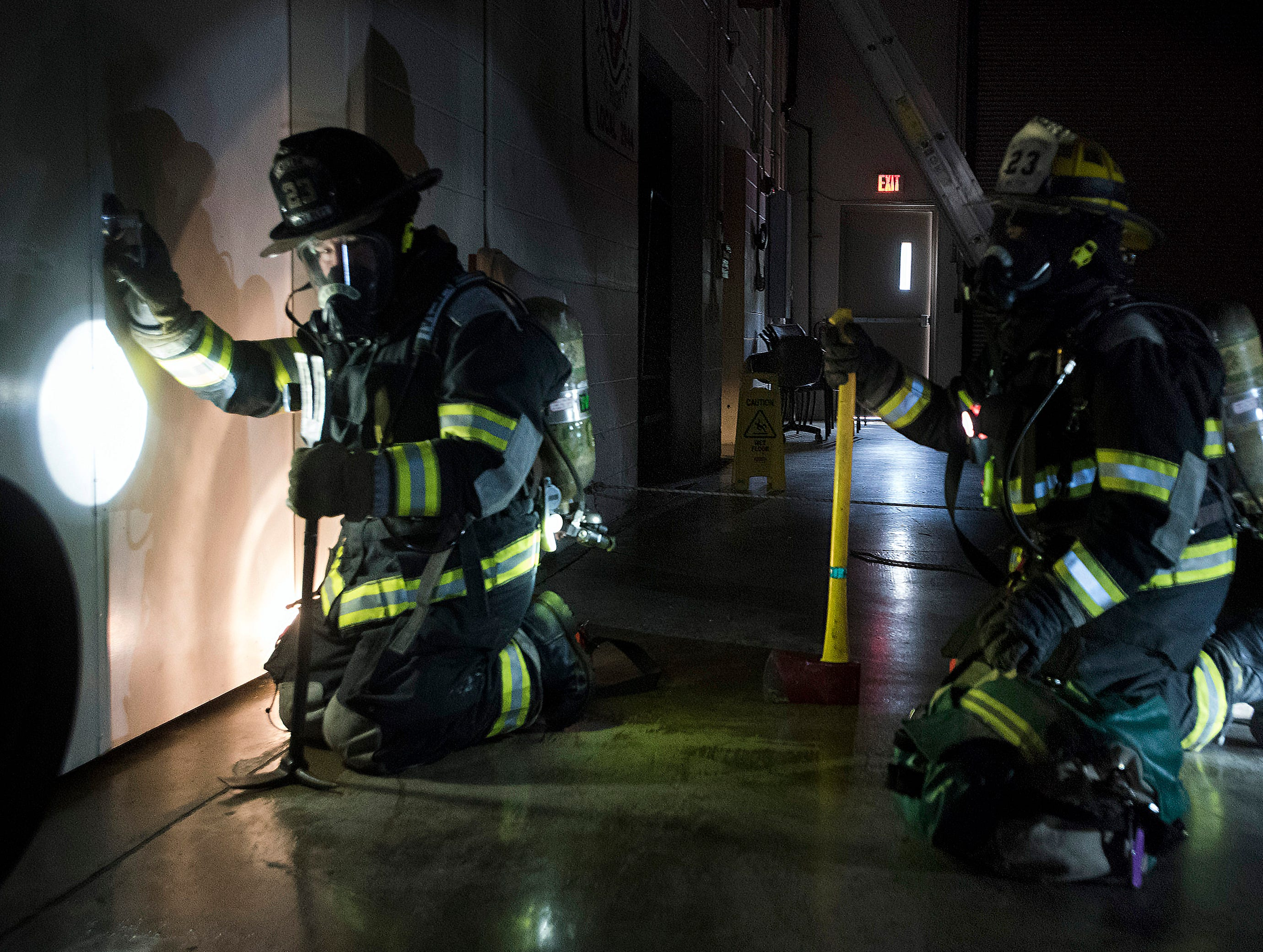 Milton Firefighters Peyton Blackledge and Steve Maddox train for survivor rescue operation at the Stewart Street fire station on Thursday, Feb. 7, 2019. The Milton FD released its annual report this week and said their calls for service increased exponentially last year.