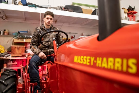 Jason Penton poses for a photo on his fully restored 1949 Massey-Harris Pony tractor at his home in Mount Joy Township. Penton put 137 hours of work into the restoration over the course of 10 months.