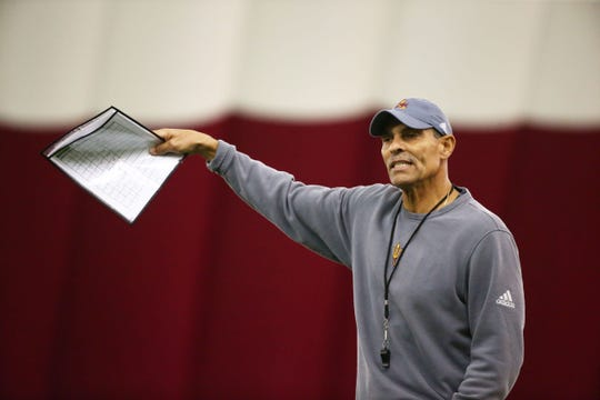 Arizona State head coach Herm Edwards leads his team during a spring football practice on Feb. 6 in Tempe.