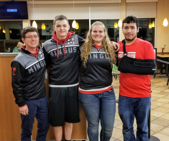 Cottonwood Mingus wrestling coach Klint McKean (far left) stands with team captains (second from left to right) Michael Thurman, Danni Schulz, and Zach Moreno.