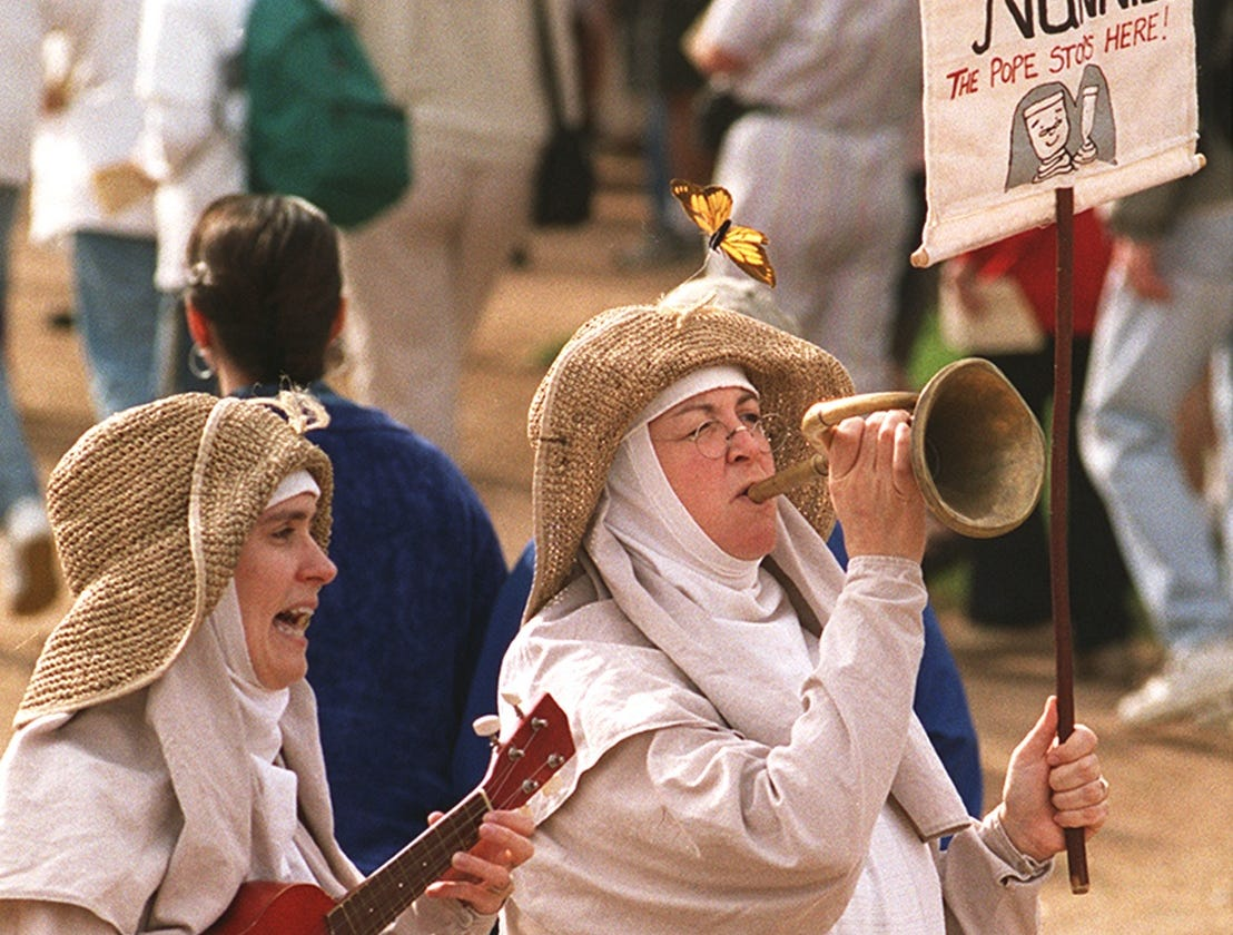 Dana McCain (left) and Shanon O' Brian of Hey Nunnie Nunnie, the Silly Singing Nuns, greet  guests entering The Arizona Renaissance Festival near Apache Junction in 2001.