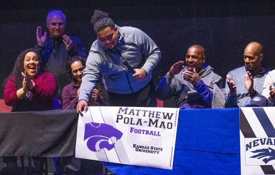 Matthew Pola-Mao, with his parents, Carrie, third from left, and Tracey Pola-Mao, announce that he will play football for Kansas State University during a signing event at the Chandler Center for the Arts, Wednesday, February 6, 2019.