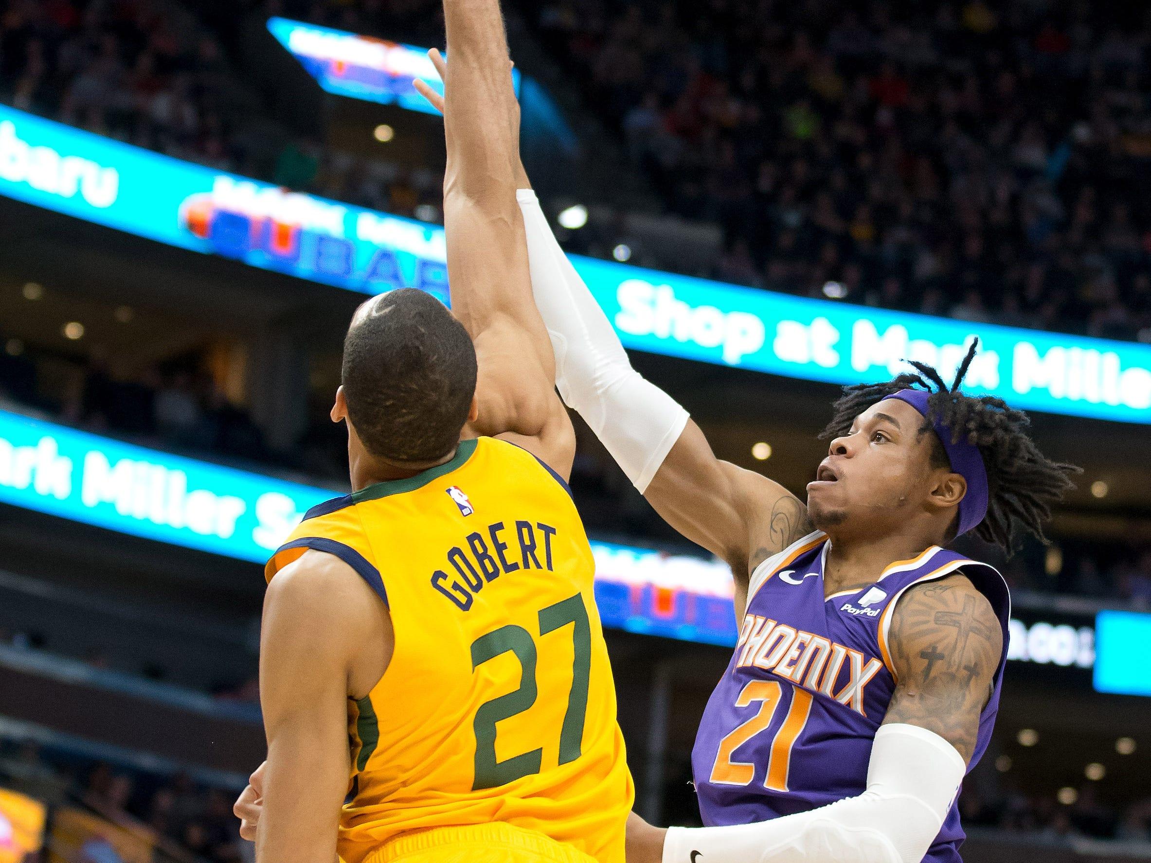 Feb 6, 2019; Salt Lake City, UT, USA; Utah Jazz center Rudy Gobert (27) blocks the shot of Phoenix Suns forward Richaun Holmes (21) during the first half at Vivint Smart Home Arena. Mandatory Credit: Russ Isabella-USA TODAY Sports