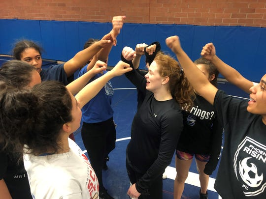 Chandler's Stefana Jelacic, center, leads the team in a post-practice chant.