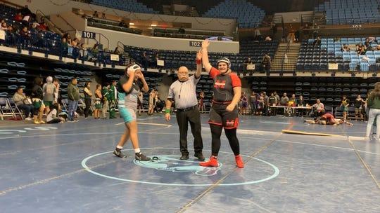 Cottonwood Mingus senior wrestler Danni Schulz wins match against Destiny Magdaleno of Pinon.