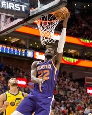 Feb 6, 2019; Salt Lake City, UT, USA; Phoenix Suns center Deandre Ayton (22) shoots the ball over Utah Jazz center Rudy Gobert (27) during the first quarter at Vivint Smart Home Arena. Mandatory Credit: Russ Isabella-USA TODAY Sports