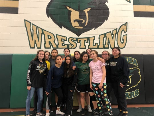 The girls wrestling team at Basha High School.