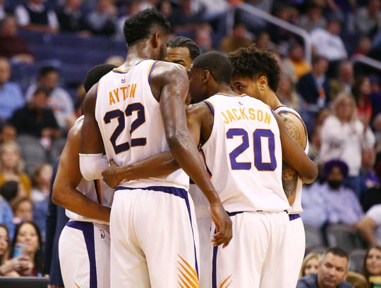Suns forward Josh Jackson rallies his teammates during a time out in a game Jan. 8 against the Kings at Talking Stick Resort Arena.