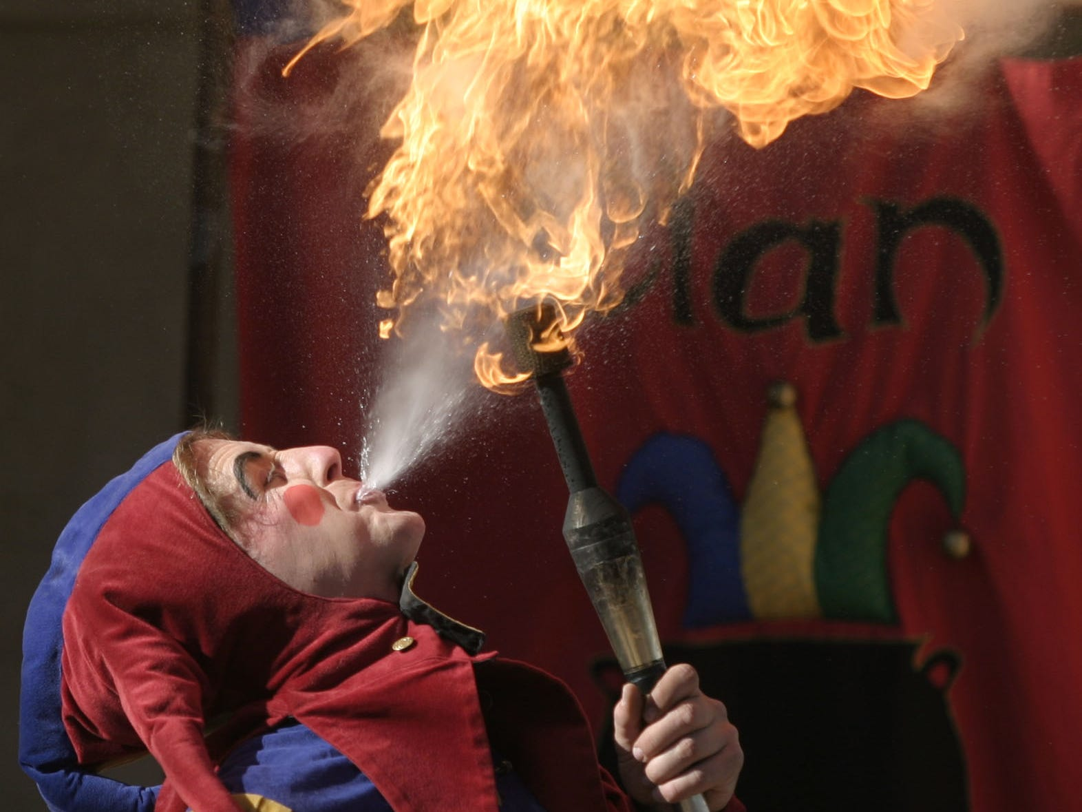 Elijah Tynker blows a fire ball on the Teatro de la Rosa stage during a performance at the Arizona Renaissance Festival in 2004.
