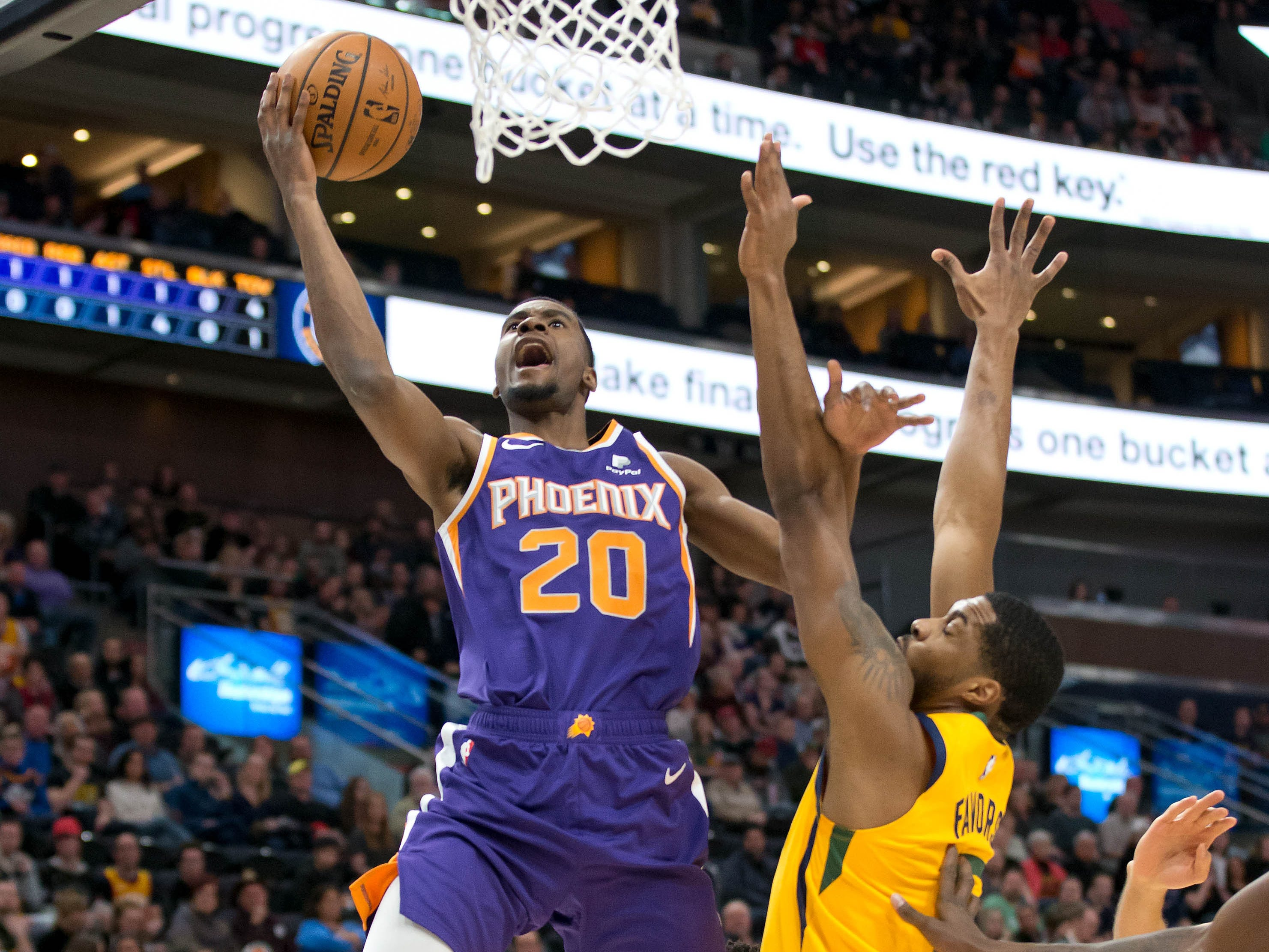 Feb 6, 2019; Salt Lake City, UT, USA; Phoenix Suns forward Josh Jackson (20) shoots the ball against Utah Jazz forward Derrick Favors (15) during the first quarter at Vivint Smart Home Arena. Mandatory Credit: Russ Isabella-USA TODAY Sports