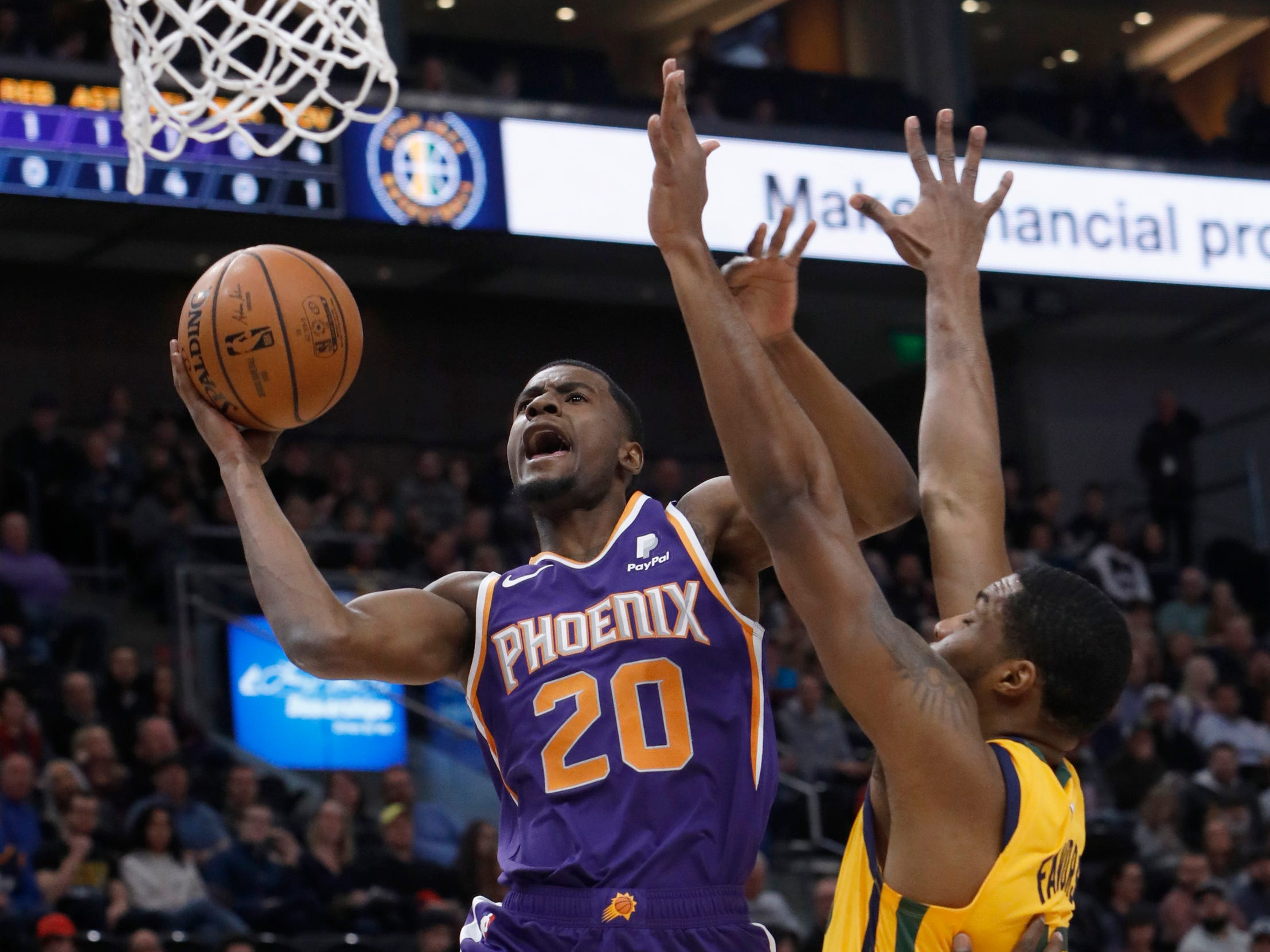 Phoenix Suns' Josh Jackson (20) attempts a layup as Utah Jazz forward Derrick Favors, right, defends in the first half of an NBA basketball game on Wednesday, Feb. 6, 2019, in Salt Lake City. (AP Photo/Kim Raff)