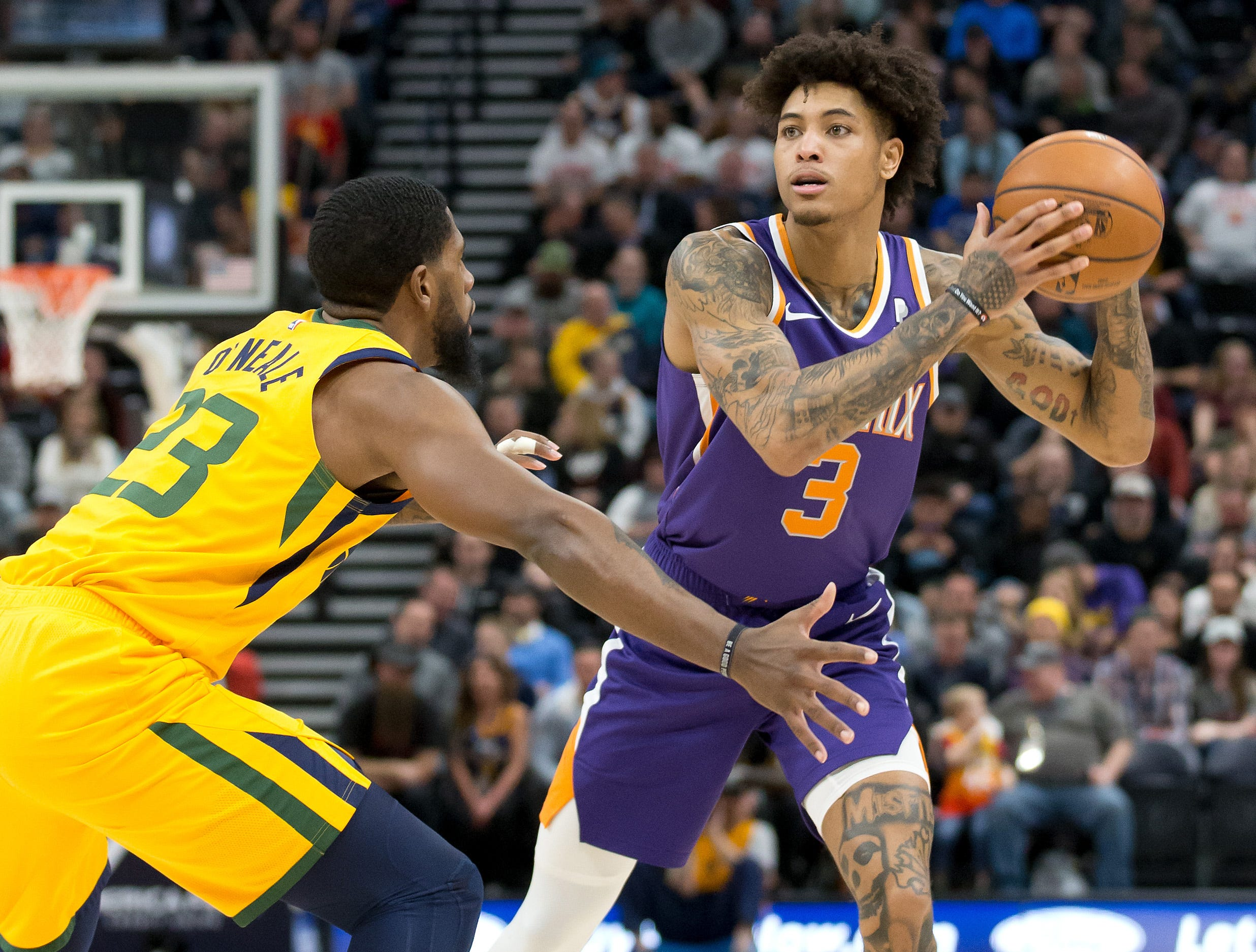 Feb 6, 2019; Salt Lake City, UT, USA; Phoenix Suns forward Kelly Oubre Jr. (3) looks to pass against Utah Jazz forward Royce O'Neale (23) during the first half at Vivint Smart Home Arena. Mandatory Credit: Russ Isabella-USA TODAY Sports