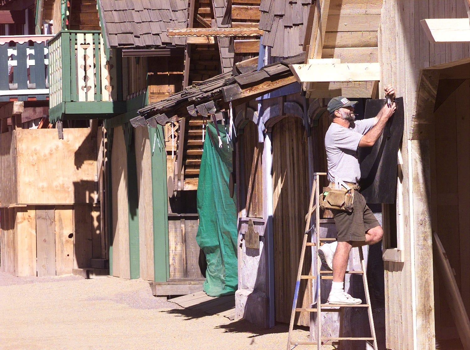 John Lidington helps prepare the Renaissance villiage for opening in 1999.