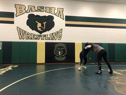Basha's Amber Rodriquez and Trinity Howard drill during practice.