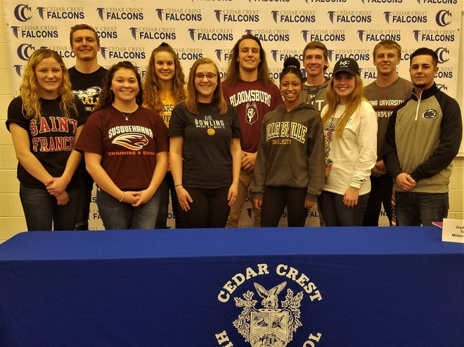Cedar Crest High School held a National Signing Day ceremony on Wednesday to recognize student-athletes who have committed to continuing their academic and athletic careers at the college level. They are, front row from left, Krysta Weik (St. Francis University, swimming), Kaite Mowery (Susquehanna University, swimming), Meghan Yingst (Mount St. Mary's University, bowling), DeAsia Holloman (Millersville University, track and field), Desiree Leffler (Lebanon Valley, soccer), Daniel Mancill (Penn State University – Brandywine, baseball). Back row, Gabe Deiderick (LaSalle University, swimming), Hannah Woelfling (Millersville University, track and field), Nick Stout (Bloomsburg University, football), Kyle Poorman (Rochester Institute of Technology, baseball), Logan Horn (Indiana University of Pennsylvania, football).
