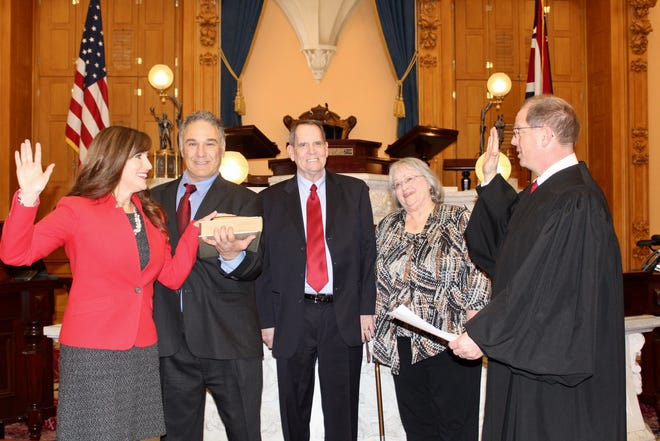 State Sen. Theresa Gavarone, R-Bowling Green, is joined by her husband, Jim, and her parents Jim and Mary Charter as she is sworn in as the Ohio Senate's newest member, representing the 2nd District.