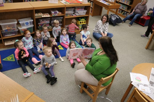 "Brenda Lochotzki reads a Valentine's Day-themed book for this week's ""One Size Fits All Story-Time"" at the Oak Harbor Public Library."