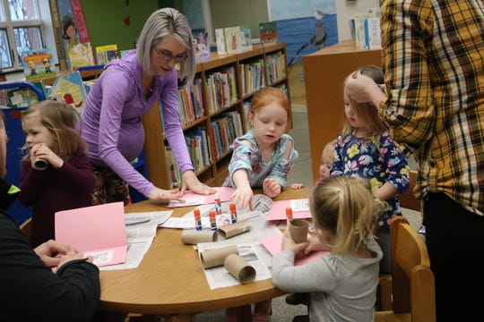 "Children make homemade Valentine's Day cards at this week's ""One Size Fits All Story-Time"" at the Oak Harbor Public Library."