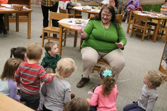 "Brenda Lochotzki plays a Valentine's Day-themed with local children at this week's ""One Size Fits All Story-Time"" at the Oak Harbor Public Library."