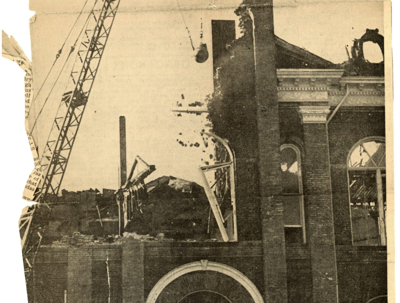 Several days after the fire, a wrecking ball is brought in to knock down some of the walls.
