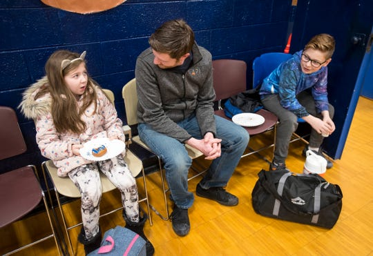 Josh Mills talks with his kids Madelyn, 9, left, and Mason, 13, right during the annual Super Dads and Donuts Thursday, Feb. 7, 2019 at Memphis Elementary School.