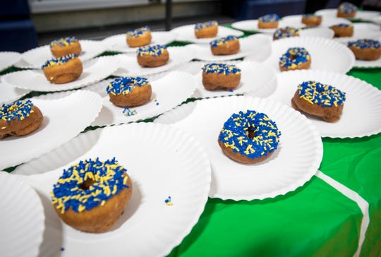 Sprinkled donuts sit on a table inside the gymnasium at Memphis Elementary School Thursday, Feb. 7, 2019 during the school's annual Super Dads and Donuts.