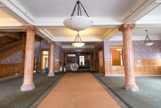 In the hotel's lobby, developers plan to remove the carpet and expose the original marble floor. They also plan to update the wallpaper.