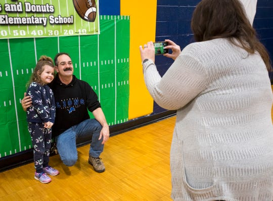 George French, center, poses for a photo with his daughter Felicia, 5,  during the annual Super Dads and Donuts Thursday, Feb. 7, 2019 at Memphis Elementary School.