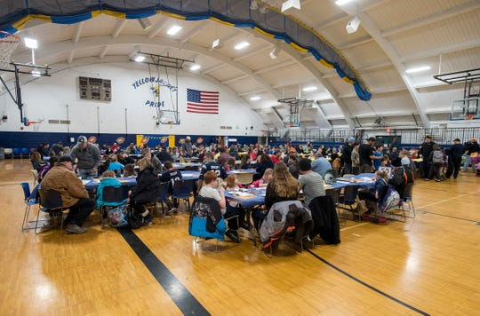 Families fill the gymnasium during the annual Super Dads and Donuts Thursday, Feb. 7, 2019 at Memphis Elementary School.