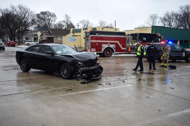 A vehicle sits smashed near 10th and Beard streets in Port Huron Thursday afternoon.