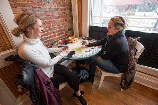 Brandi Bowman, left, and Shannon Muir talk at a table inside Kate's Downtown Thursday, Feb. 7, 2019.
