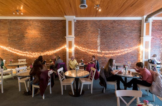 Patrons are seated at tables inside Kate's Downtown Thursday, Feb. 7, 2019.