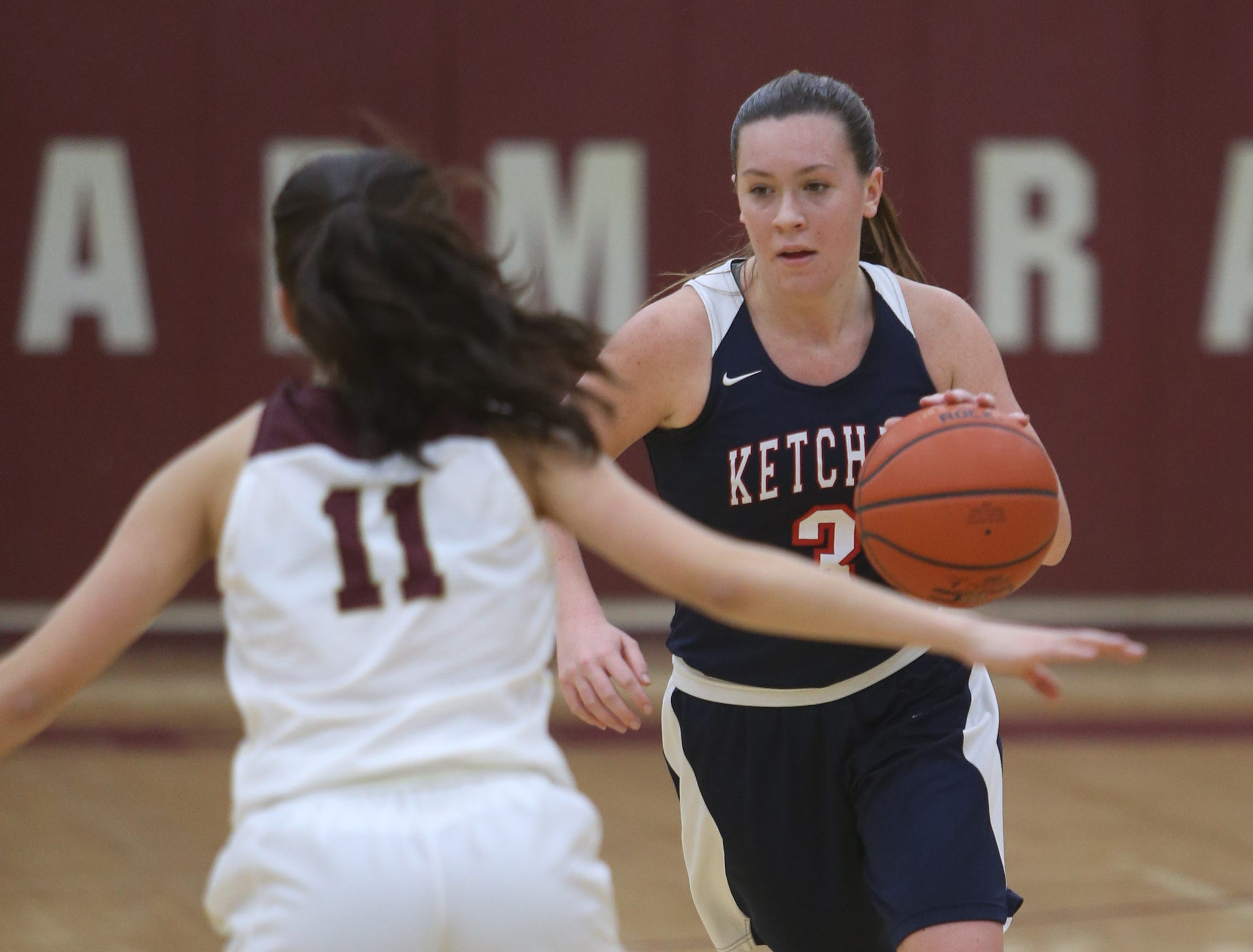 Ketcham's Katie Wall evades Arlington's Camille Loussedes during Wednesday's game in Freedom Plains on February 6, 2019.