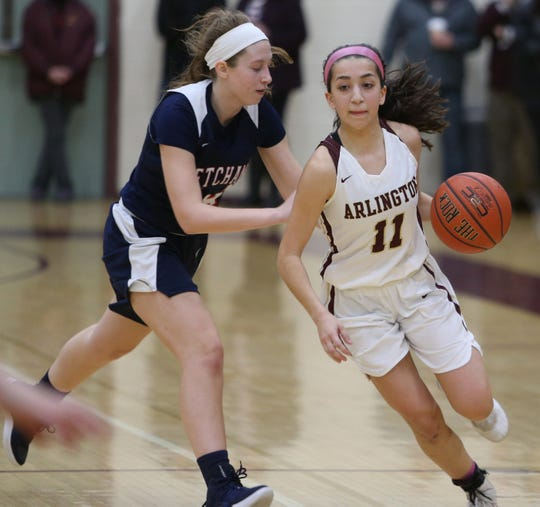 Arlington's Camille Loussedes clears Ketcham's Meg Nardelli during Wednesday's game in Freedom Plains on February 6, 2019.
