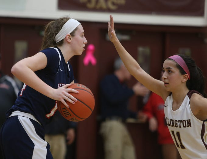 Ketcham's Meg Nardelli looks to pass the ball away from Arlington's Camille Loussedes during Wednesday's game in Freedom Plains on February 6, 2019.