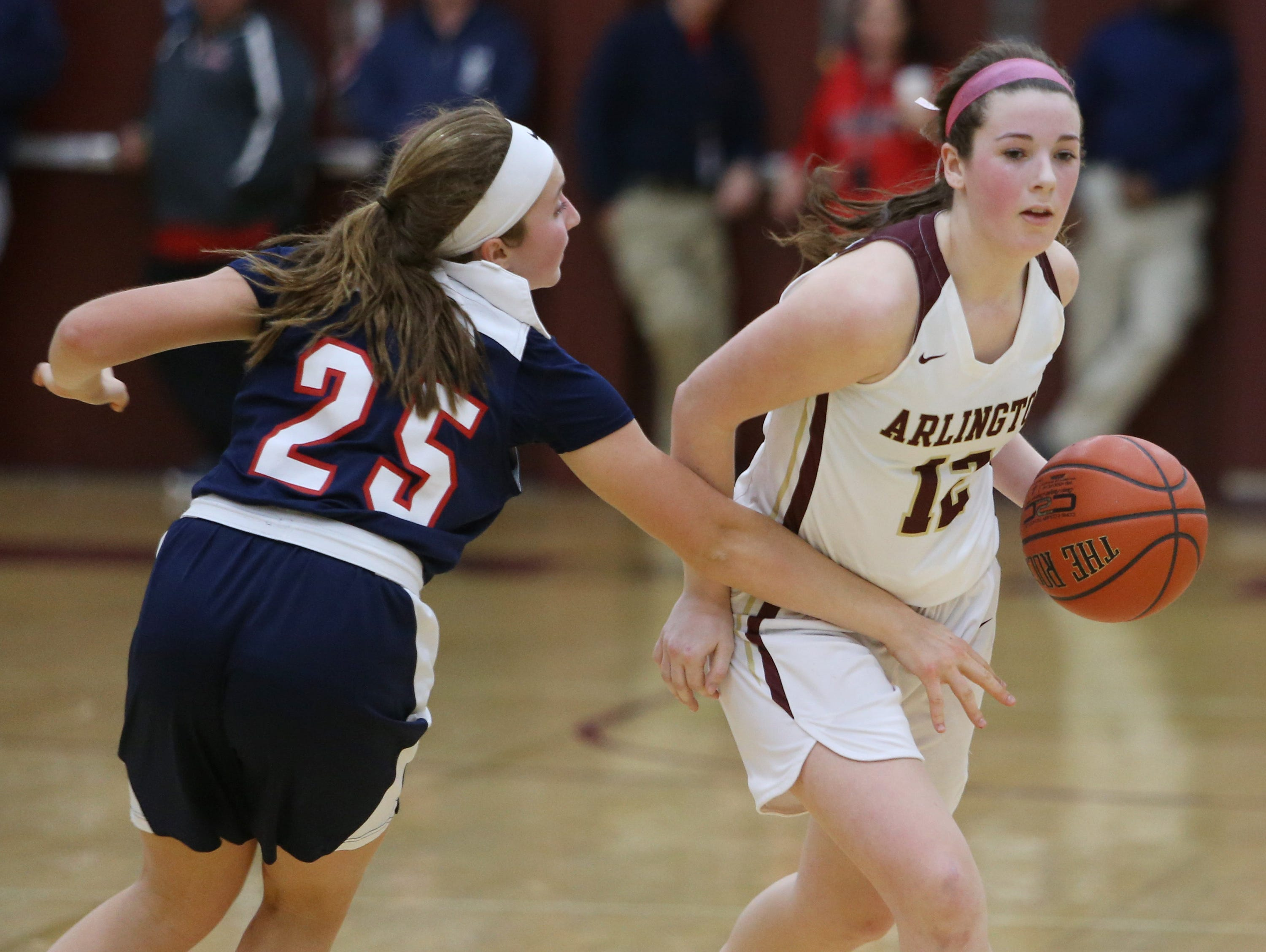 Arlington's Molly Stephens evades Ketcham's Abby Mealy during Wednesday's game in Freedom Plains on February 6, 2019.